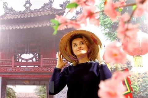Une photographe russe impressionnée par lao dài du Vietnam