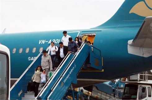 Des passagers de Vietnam Airlines.