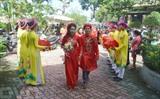 Le mariage collectif pour les travailleurs en difficulté, organisé le 2 décembre dans la ville de Dà Nang (Centre). Photo: Dinh Nhiêu/VNA/CVN