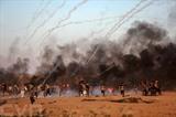 Des manifestants palestiniens lors des affrontements à la frontière entre Gaza et Israël, à l'est de la ville de Gaza, le 10 août. Photo: Xinhua/VNA/CVN<br />