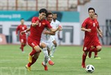 Des footballeurs vietnamiens (maillot rouge) lors du match avec le Pakistan, le 14 août, en Indonésie. Photo: Hoàng Linh/VNA/CVN