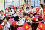 Les écoliers sont enthousiastes lors de la rentrée de la nouvelle année scolaire 2018-2019, le 5 septembre. Photo: Lê Lâm/VNA/CVN