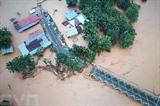 Des inondations causées par des crues et glissements de terrain dans la province de Sulawesi, en Indonésie, le 12 juin. Photo: AFP/VNA/CVN
