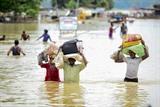 De fortes inondations à Allahabad en Inde ont entraîné l'évacuation de habitants.Photo: AFP/VNA/CVN