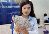 Les réserves de devises du Vietnam se sont élevées à 92 milliards d'USD, approchant de l'objectif de 100 milliards fixé pour cette année. Photo : VNA/CVN