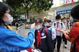 Le 2 mars 2021, les élèves de Hanoï sont retournés à l'école après de longs congés du Têt destinés à prévenir l'épidémie de COVID-19. Photo : VNA/CVN