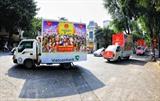 Des véhicules de communication sur les élections législatives dans une rue de Hanoï. Photo : Thành Dat/VNA/CVN